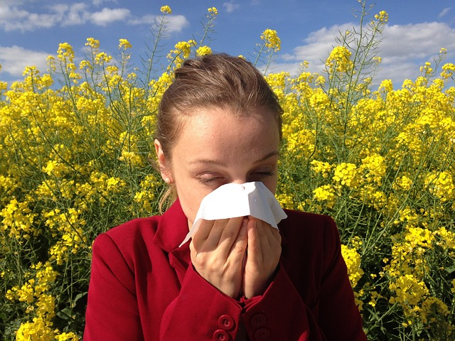 girl in field with allergies