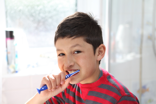 child brushing