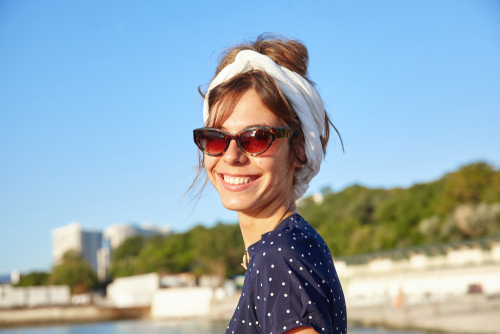 smiling woman on coastline
